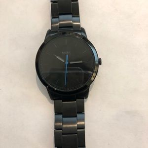 Men's black Fossil watch.